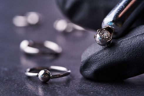 Piercing earrings close-up. On a black background.jpg