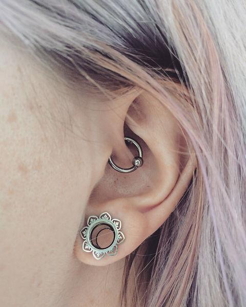 A daith piercing and beautiful ear stretcher.jpg