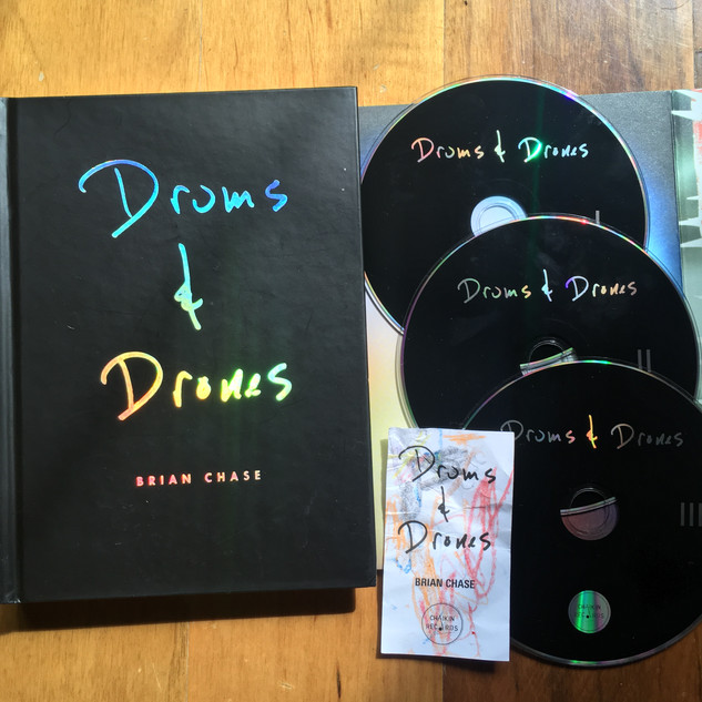 Book, three CDs, and download card