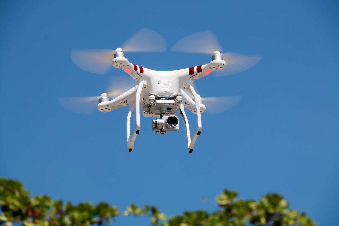 drone-flying-against-blue-sky-336232.jpg