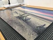 Photo d'un tirage grand format d'Antoine Tatin contrecolle sur alu dibond representant un lever de soleil sur une plage des Sables d'Olonne.