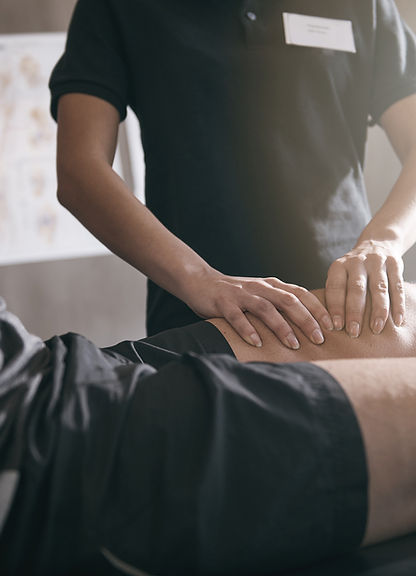 thigh massage technique, performing sports recovery upper leg massage