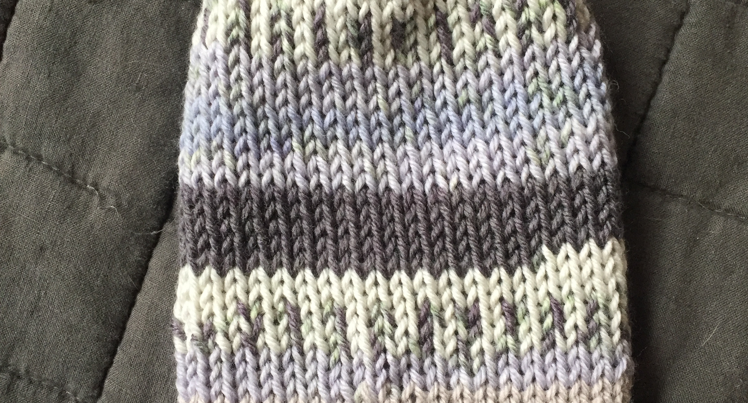 Blue, grey, and cream striped and spotted knit kids' hat