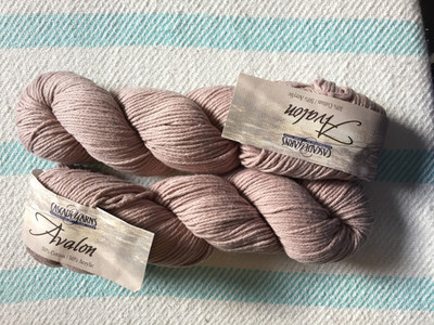 Two skeins of Cascade Avalon yarn in a dusty warm taupe