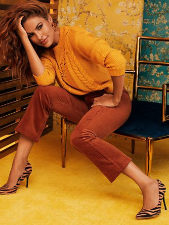 Eva Mendes in a mustard sweater with copper pants