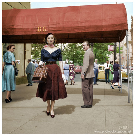 Model on the Street  Photographs show men and women looking at fashion model Doris Erwin as she walks down Fifth Avenue, New York City. 1952.