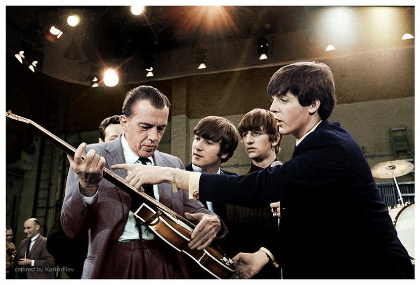 The Beatles teach Ed Sullivan how to play the guitar. 1964