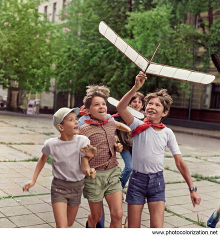 Children launch a model of airplane. 1970s