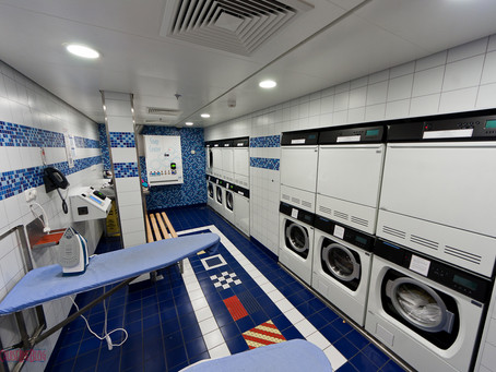 24 Hour Laundromat with Wash & Fold, Pickup & Delivery, Dry Cleaning, & Commercial Laundry Services
