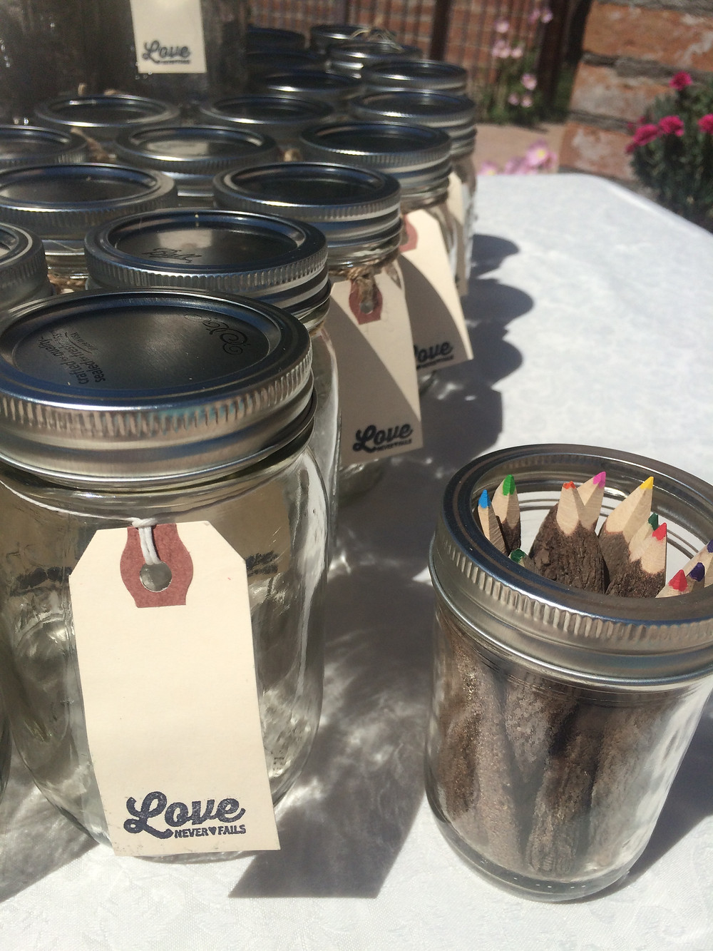 Mason jars with labels guests write their own names