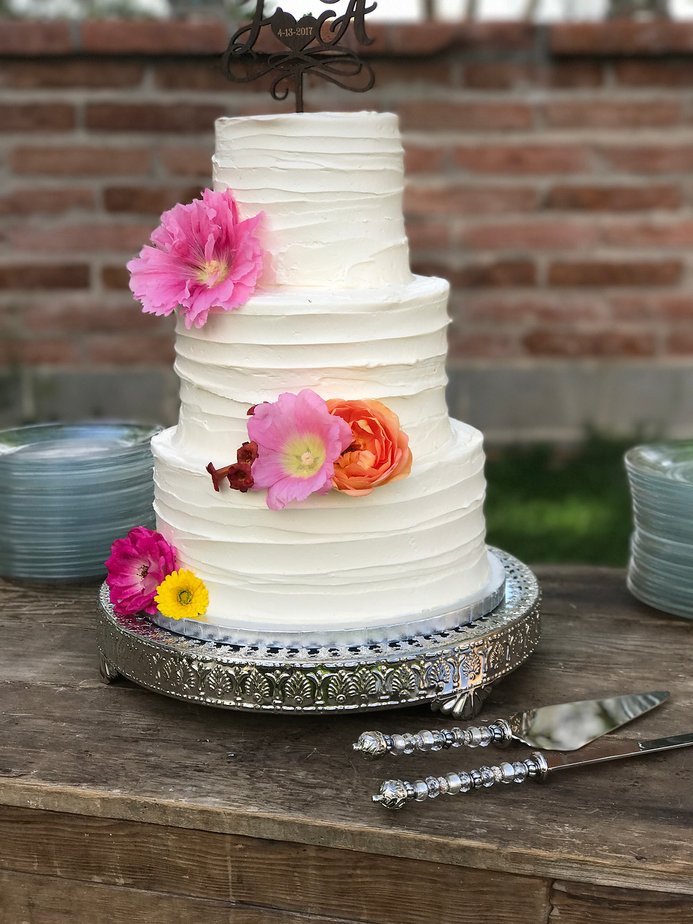Wedding cake decorated with flowers from the garden.
