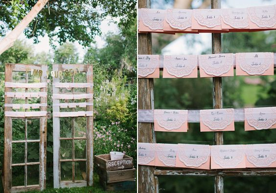 Escort cards with table assignments on rustic doors at Agua Linda Farm