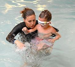 Swim teacher teaching swimmer