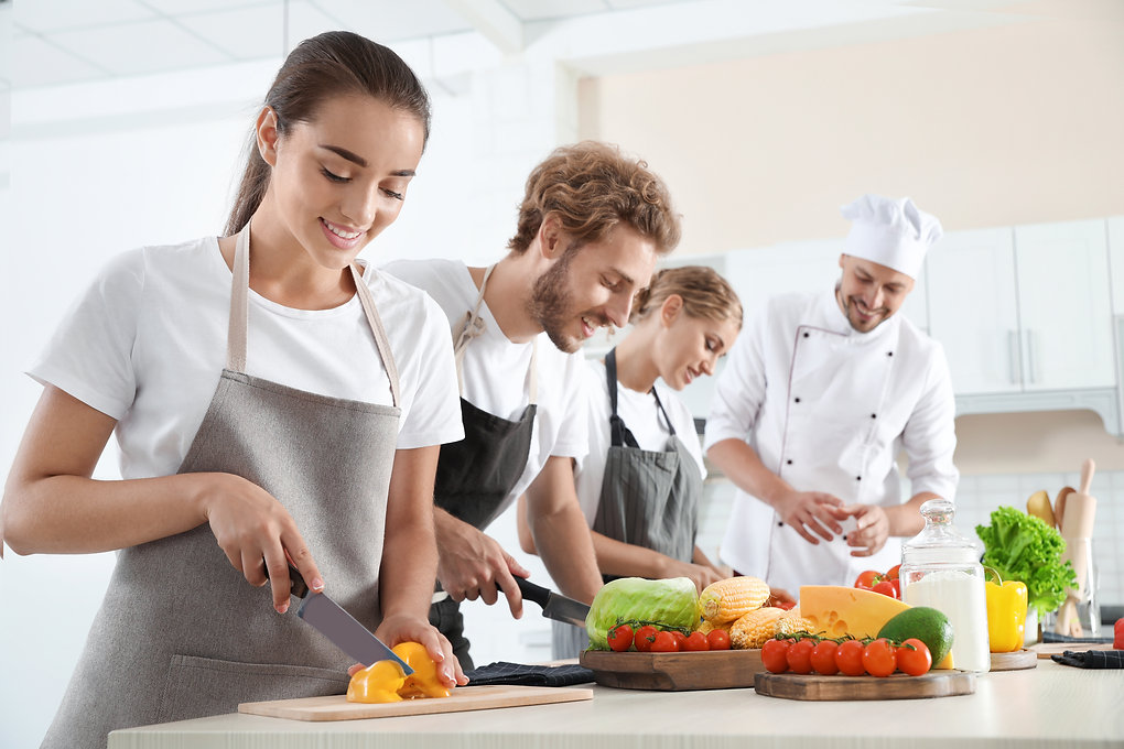 Group of people and male chef at cooking