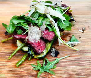 TRUFFLE BEEF TAGLIATA ON A BED OF ROASTED GREEN VEGETABLES