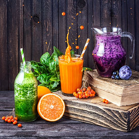 Fresh juice and smoothies with berries, fruits and green spinach on wooden background  .jp