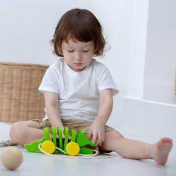 plan-toys-dancing-alligator-wooden-child