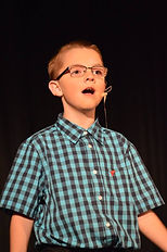 A young boy singing.