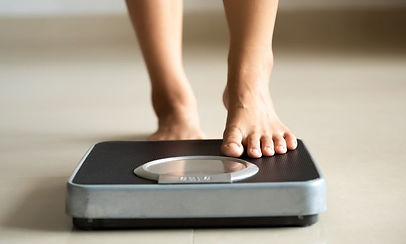 bare-foot-stepping-onto-bathroom-scale-7
