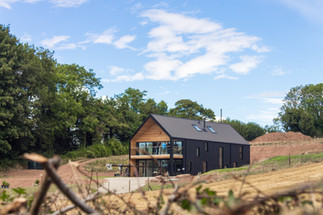 Barn House cut into the landscape, reducing visual impact