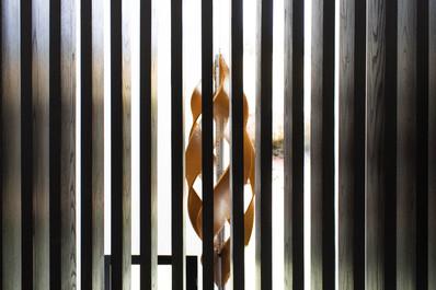 Light Sculpture seen through Screen Wall