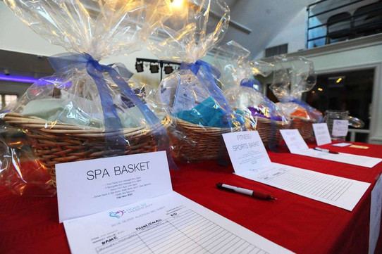 Gift baskets are up for auction at The Pop Music Academy to help raise funds for Hope in Harmony.