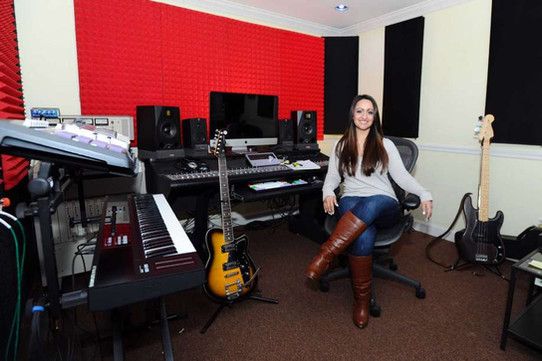 Christine Occhino, owner of The Pop Music Academy, poses for a photo in her studio. Occhino is raising funds for her new non-profit called Hope in Harmony, which brings music and music therapy to patients in area heathcare facilities.