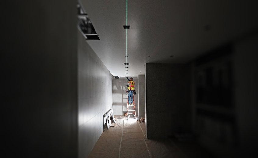 AH Field Employee working to center lights brighter.jpg