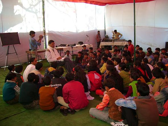 PK Siddharth Addressing Children In Delhi Camp.jpg