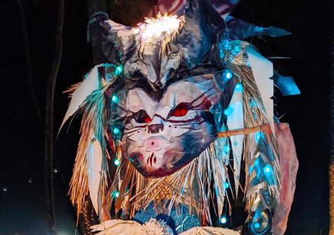 Boreal Totem Illuminated at night