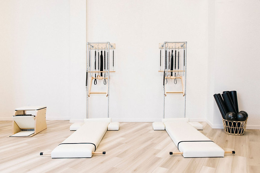 wall units with foam rollers and chair.j