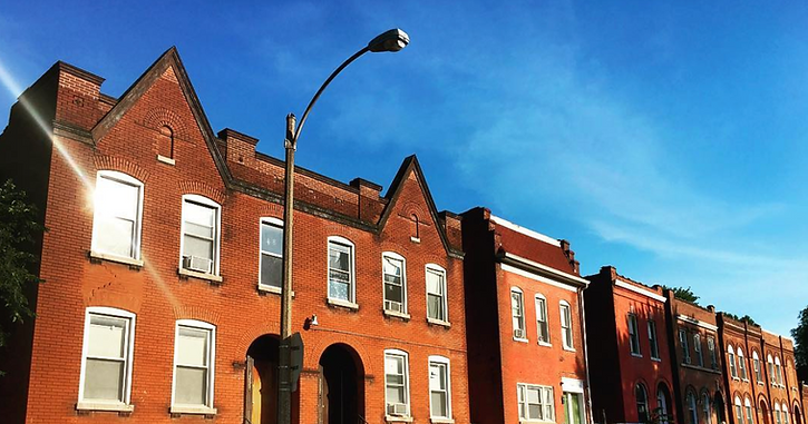 a photo of the top of a row of brick buildings in St. Louis