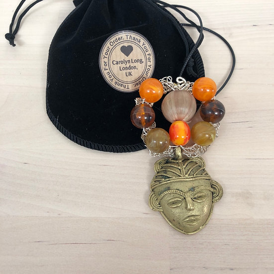 Glorious upcycled pendant in velvet pouch
