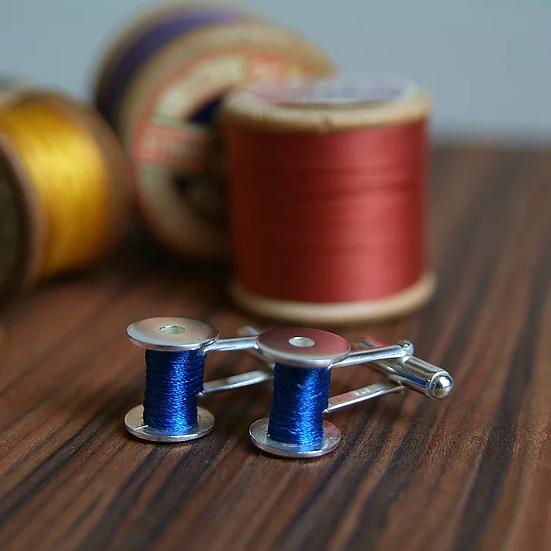 Blue reel cufflinks in sterling silver