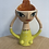Thumbnail: Madeline Herbert -Egg cup with orange hair, lime green dress and gold detailing.