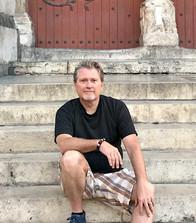 Mike Simpson in front of door_edited.jpg