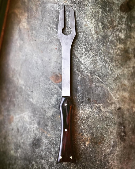 The pareusi flame carving fork .