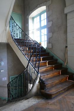 Escalier à rampe en fer forgé