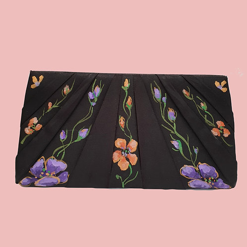 Floral painted clutch bag by Mihaela Panaitescu