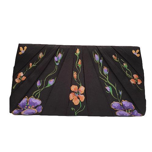 Floral painted clutch bag by Mihaela Panaitescu