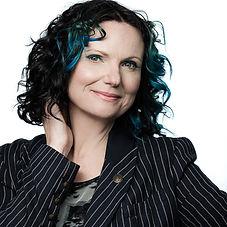 Clare Reeves Headshot Colour 2021.jpg