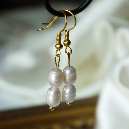medium ivory rice pearl hook earrings