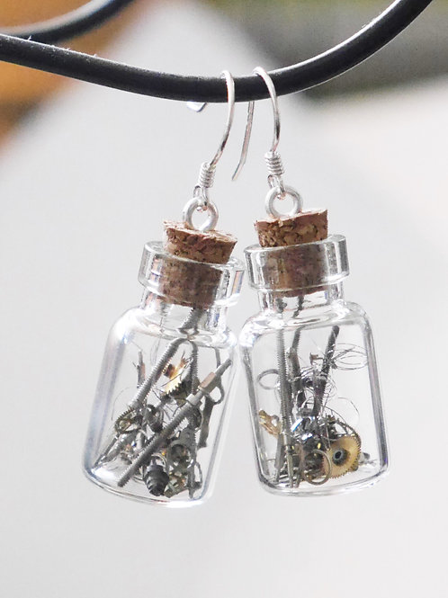 mini glass bottles filled with vintage watch parts earrings