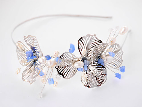 silver flower tiara with blue stones and pearls