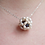 Thumbnail: ivory rice pearl sphere around a large black pearl