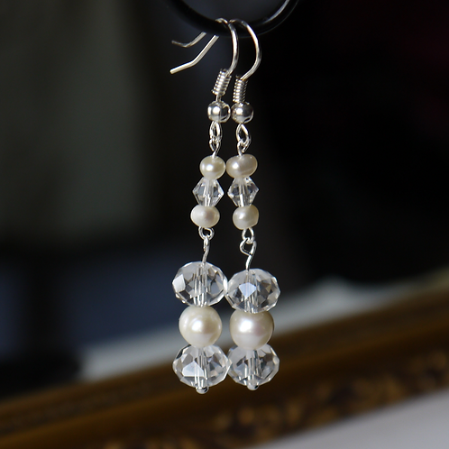 clear crystal & ivory pearl articulated earrings