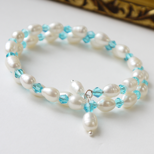aqua crystal & ivory rice pearl coil bracelet