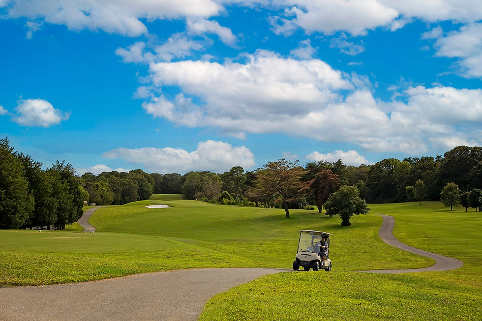 Chesapeake Hills Golf Course with man on golf cart