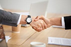 closeup-view-handshake-two-businessmen-s