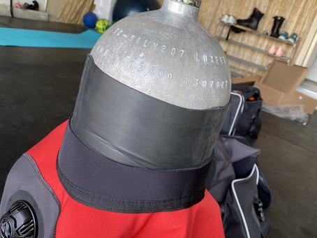What to do with a neck seal that's too tight from a brand new dry suit?